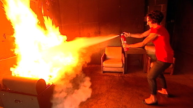 PHOTO: Volunteers at the Bergen County Law and Public Safety Institute were given fire extinguishers and tested on their use.