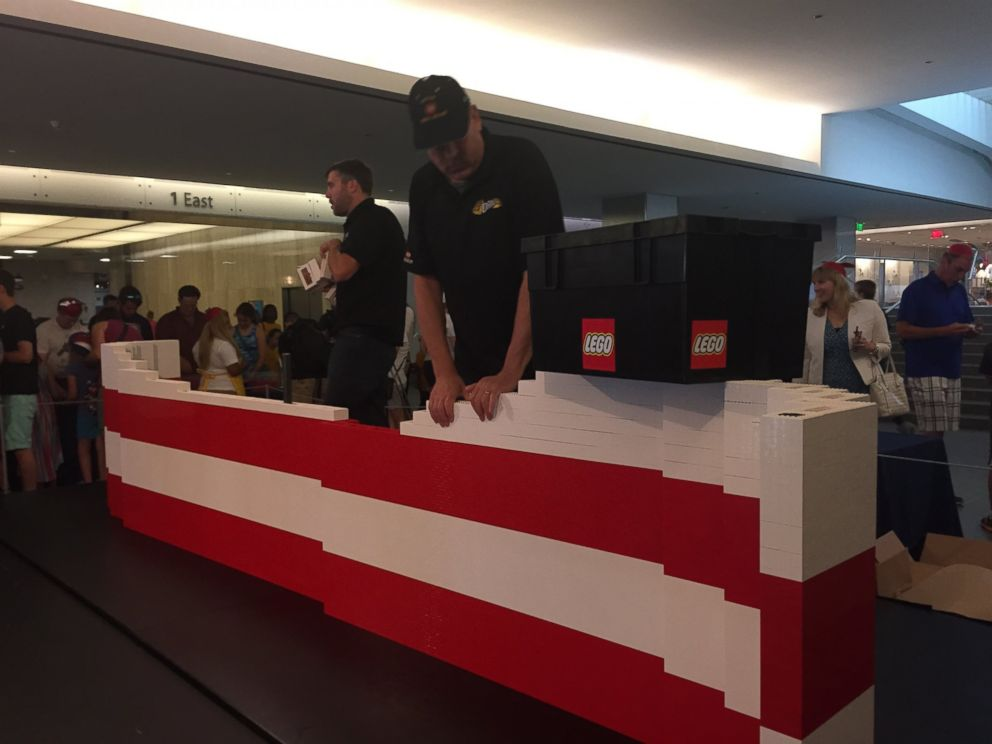 PHOTO: More than 15,000 museum visitors helped father-son LEGO master builder team Dan and Chris Steininger create the 9.5-by-14-foot flag.