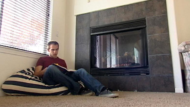 PHOTO: Third-year University of California, Merced student Jeff Laird studies by the fireplace in a McMansion he shares with five other engineering students.