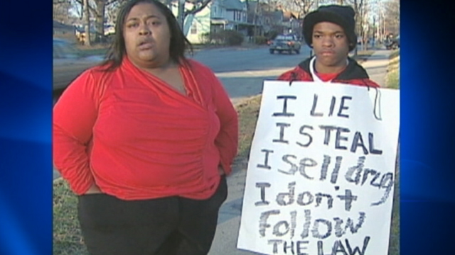 PHOTO: Dynesha Lax is making her son wear a sign that lists his numerous run-ins with police.