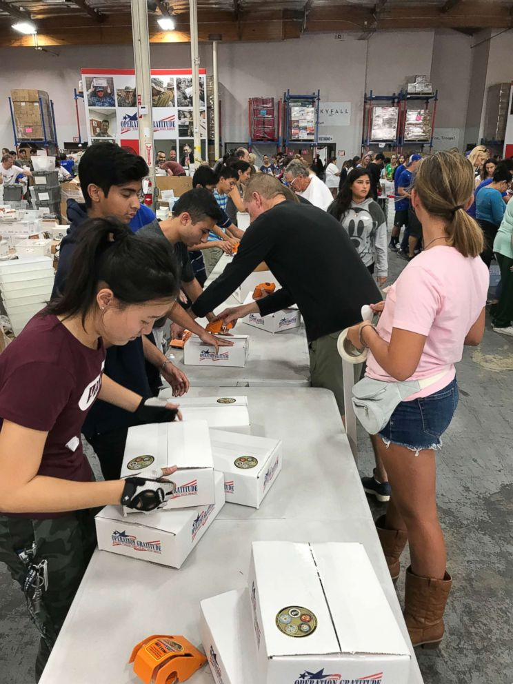 Operation Gratitude volunteers are seen here packing care packages.