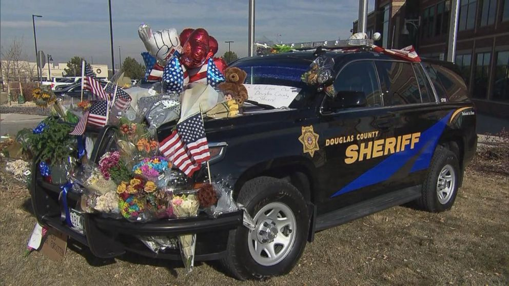 Mourners decorated Deputy Zack Parrishs police vehicle after he was killed.