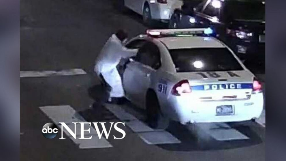 Officials say that suspected gunman Edward Archer fired at least 11 shots at Philadelphia police officer Jesse Hartnett while he was in his police vehicle.