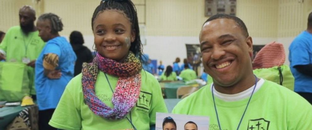 """Arkinya Graham, 8, is shown here with her father Johnny """"Trey"""" Williams during the One Day with God program at Earnest C. Brooks Correctional Facility in Muskegon, Michigan."""