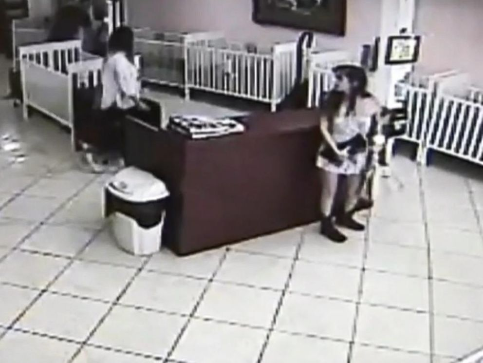 PHOTO: Surveillance footage from The Puppy Stop in Orlando, Fla. shows Carolina Mejia Urbina , 25, taking a $1,300 Yorkshire Terrier puppy, stuffing it in her purse and leaving the store without paying on Nov. 11, 2015.