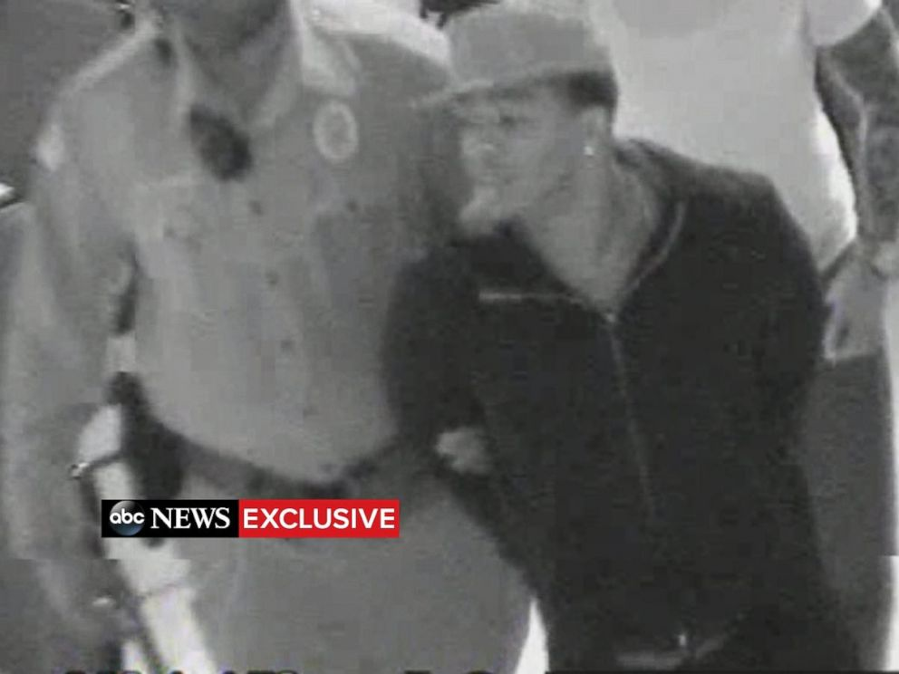 PHOTO: Video shows Ray Rice in handcuffs after he punched his wife in an Atlantic City elevator.