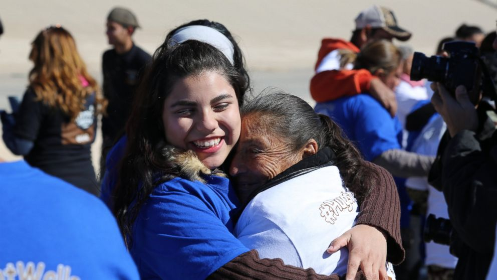 Families separated by US-Mexico border embrace in ...