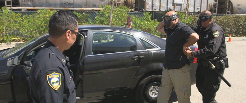 Richmond, California, police department officers are shown here turning a traffic stop training exercise.