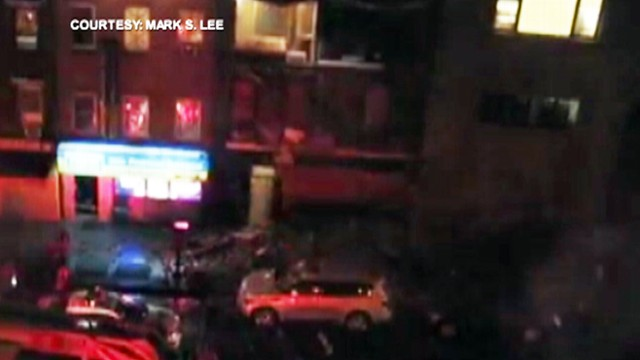 VIDEO: The exterior of a building collapses during Hurricane Sandy's heavy rains and wind.