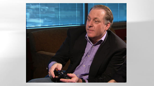 "PHOTO: Former MLB star Curt Schilling test drives his companys first video game ""Kingdoms of Amalur: Reckoning."""