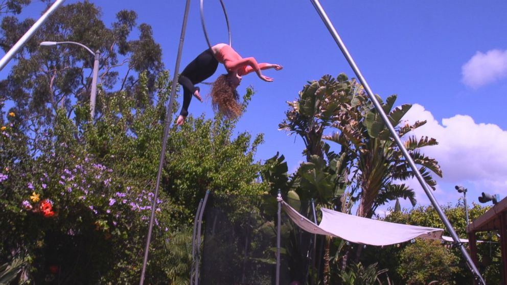 Sofie Dossi, 16, is seen here practicing in the backyard of her familys California home.