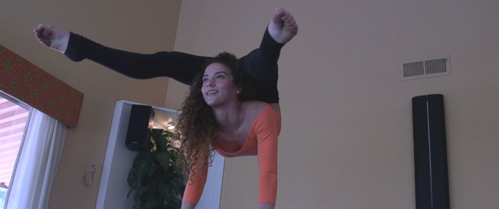 Youtube star and teenage contortionist Sofie Dossi is seen here practicing in her familys California home.
