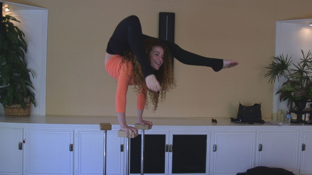 Contortionist Sofie Dossi is seen here practicing in her familys California home.