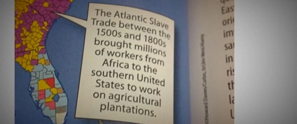 "PHOTO: A screen grab from video showing a caption inside a McGraw-Hill textbook that reads, ""The Atlantic Slave Trade between the 1500s and 1800s brought millions of workers from Africa to the southern United States to work on agricultural plantations."""