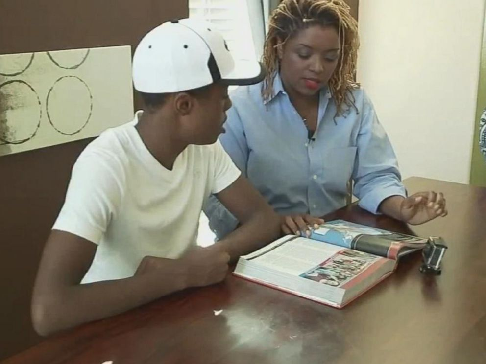 PHOTO: Coby Dean-Burren and his mother Roni Dean-Burren look through a McGraw-Hill textbook in Pearland, Texas.