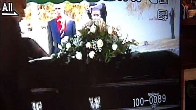 Body Falls Out of Casket at Burial