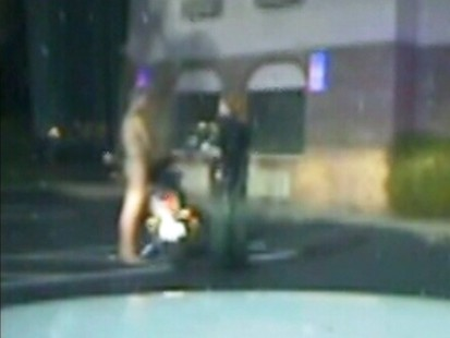 VIDEO: A man is arrested on DUI charges after riding naked on a motorcyle.
