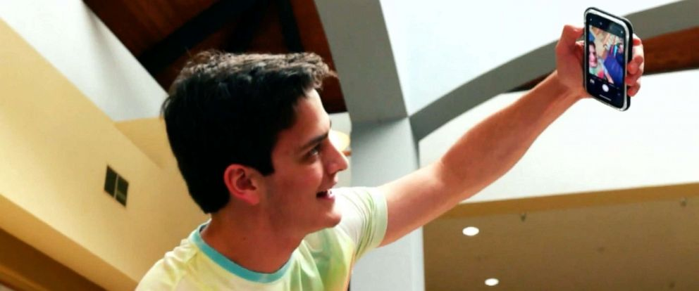 "PHOTO: An actor is seen here portraying a teenager taking insensitive selfies during an episode of ""What Would You Do?"""