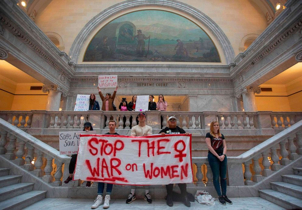 PHOTO: Abortion rights activists hold signs at a rally to oppose abortion bans and increased restrictions happening throughout the United States, at the State Capitol Building in Salt Lake City, Utah, May 21, 2019.
