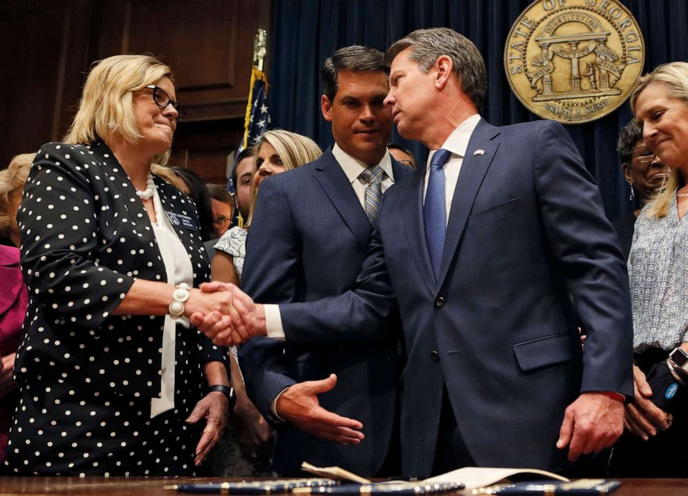 PHOTO: Georgia Gov. Brian Kemp shakes hands with state Sen. Renee Unterman after signing legislation banning abortions once a fetal heartbeat can be detected, in Atlanta, May 7, 2019.