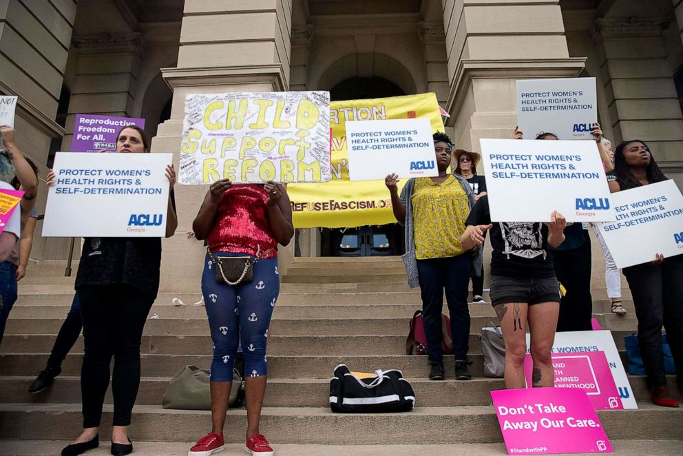 PHOTO: Abortion rights protesters rally outside of the Georgia State Capitol building following the signing of HB 481, in Atlanta, May 7, 2019.