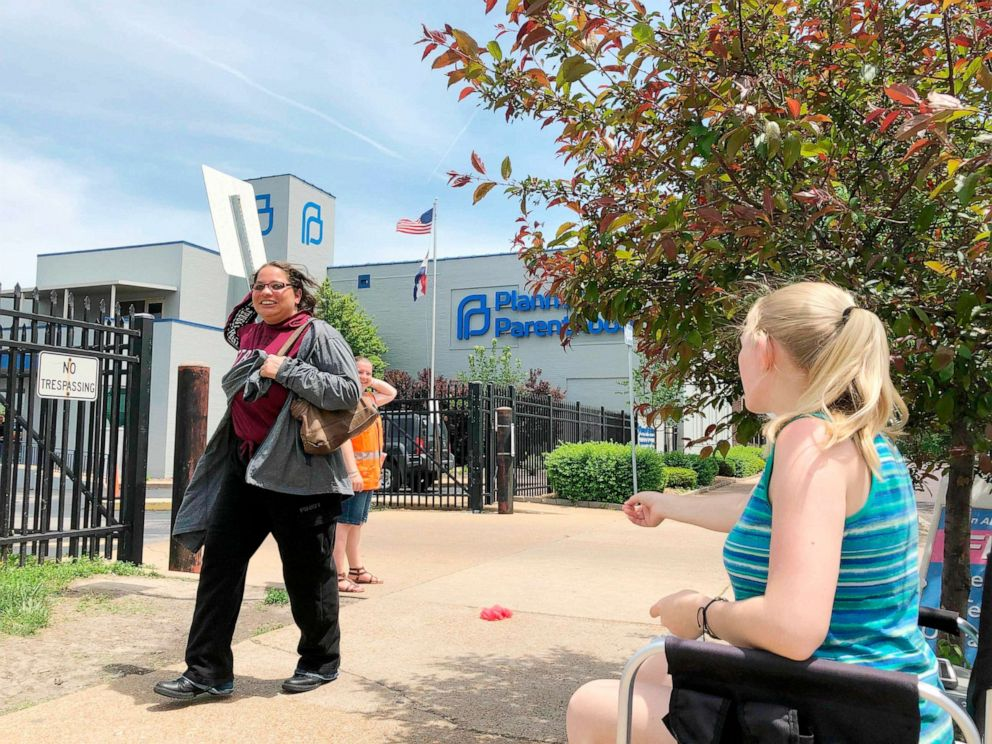 PHOTO: Teresa Pettis, 21, right, greets a passerby outside the Planned Parenthood clinic in St. Louis, Friday, May 17, 2019.