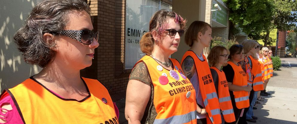 PHOTO: Escort volunteers line up outside the EMW Womens Surgical Center in Louisville, Ky., July 17, 2017.