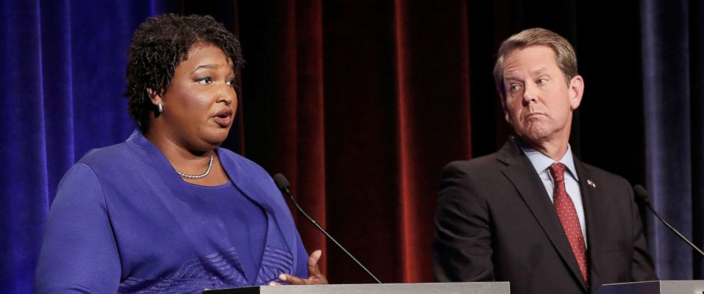 PHOTO: Democratic gubernatorial candidate for Georgia Stacey Abrams speaks, as Republican candidate Brian Kemp looks on, during a debate in Atlanta, Oct. 23, 2018.