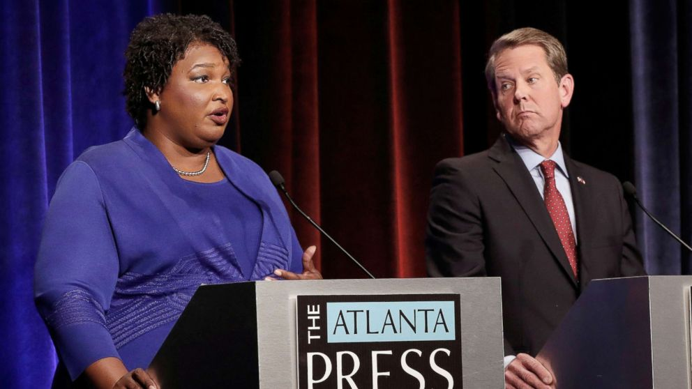Democratic gubernatorial candidate for Georgia Stacey Abrams speaks, as Republican candidate Brian Kemp looks on, during a debate in Atlanta, Oct. 23, 2018. Picture taken on October 23, 2018.