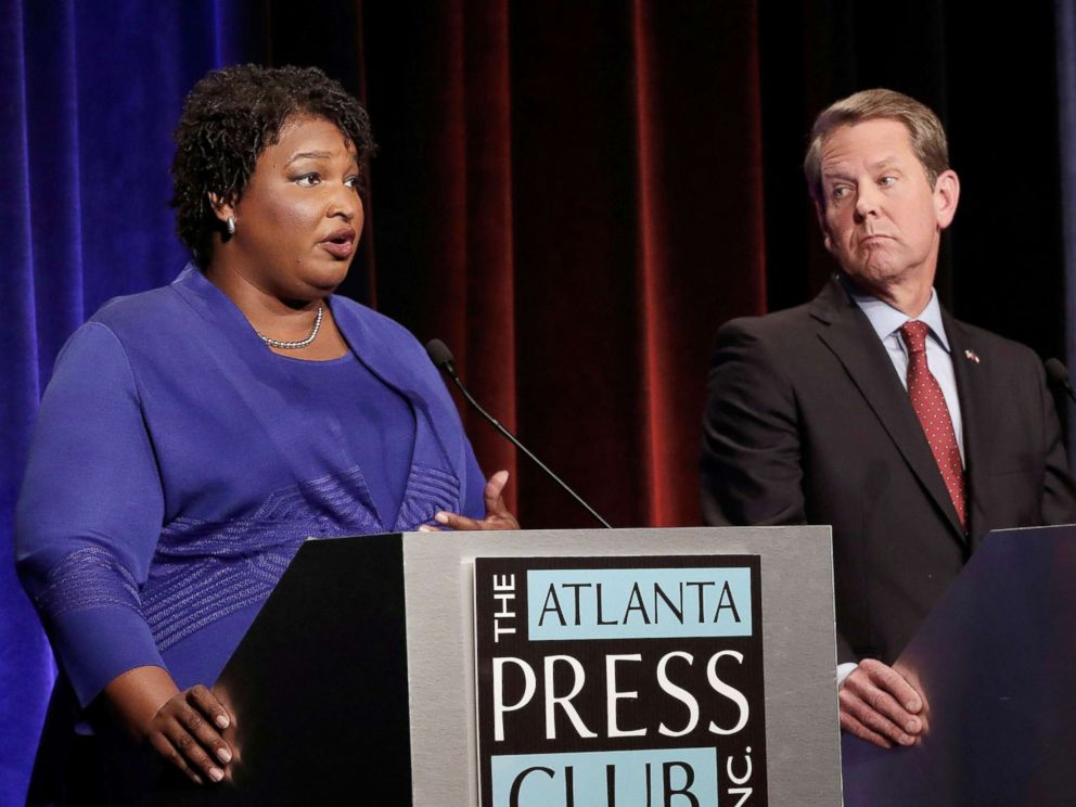 PHOTO: Democratic gubernatorial candidate for Georgia Stacey Abrams speaks, as Republican candidate Brian Kemp looks on, during a debate in Atlanta, Oct. 23, 2018. Picture taken on October 23, 2018.