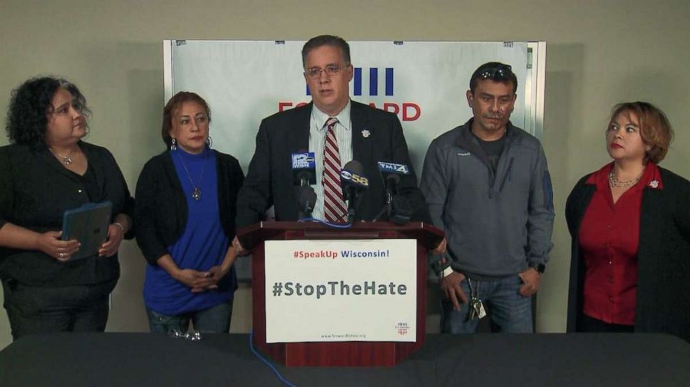PHOTO: Darryl Morin, president and chairman of the board for Forward Latino, speaks at a press conference Saturday, Nov. 2, 2019, after Mahud Villalaz, second from right, had acid thrown in his face in Milwaukee, Wis.