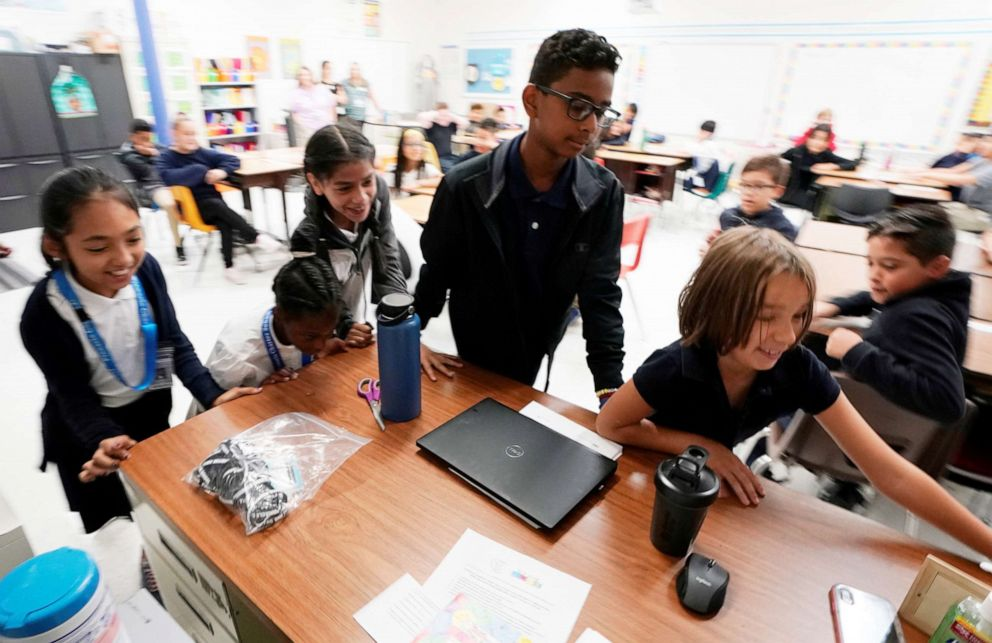 PHOTO: Fifth grade students move the teachers desk to blockade the classroom entrance door at Pinnacle Charter School during TAC*ONE training for an active shooter situation in a school in Thornton, Colorado, Aug. 29, 2019.
