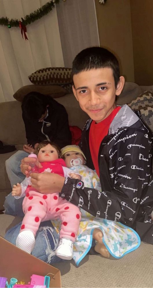 PHOTO: Adam Toledo is pictured with his cousin's 7-year-old daughter Kaylah's dolls, Jan. 1, 2021. Adam would play with them to make Kaylah laugh, his cousin told ABC News.