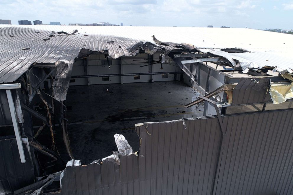 PHOTO: The charred damage to an airport hangar is seen after a twin-engine plane crashed, killing 10, on June 30, 2019, outside Dallas, Texas.
