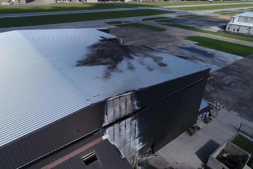 PHOTO: The charred damage to an airport hangar is viewed after a twin-engine airplane crashed, killing 10, on June 30, 2019, outdoors Dallas, Texas.
