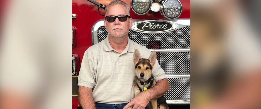 PHOTO: Capt. Paul Bryant of the North Charleston Fire Department adopted his dog Rocky after he rescued him from a pile of rocks in March, 2019.