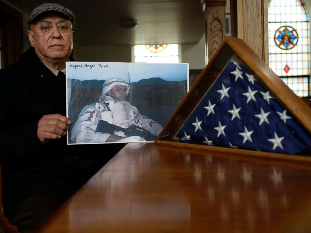 PHOTO: Miguel Perez holds a photo of his son Miguel Perez Jr., April 4, 2017, in Chicago. Perez Jr., an Army veteran is facing deportation after serving seven years in a state penitentiary on a drug charge.