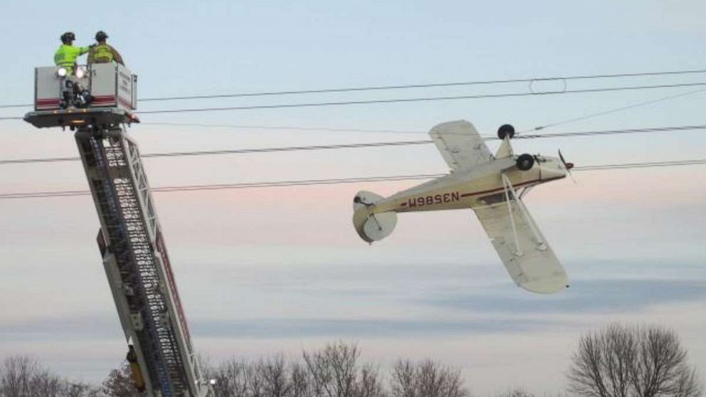 Pilot rescued after small plane becomes entangled upside down in power line thumbnail