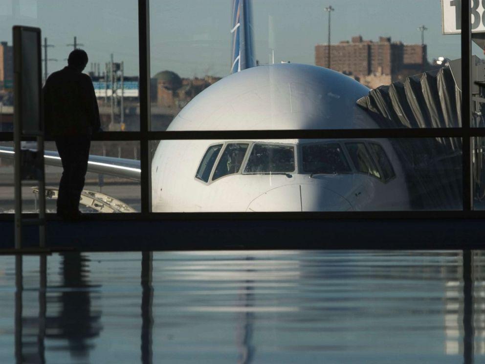 PHOTO: A passenger waits at Newark International Airport.