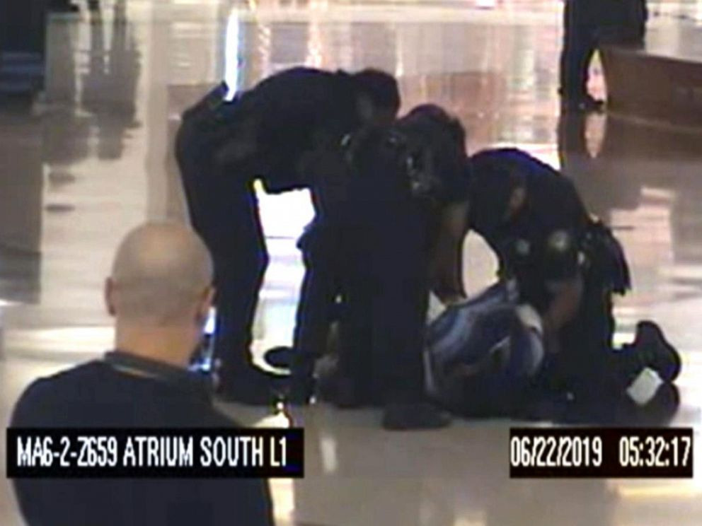 PHOTO: Police arrest a woman they say was captured on video trying to kidnap two children at the airport in Atlanta, June 22, 2019.