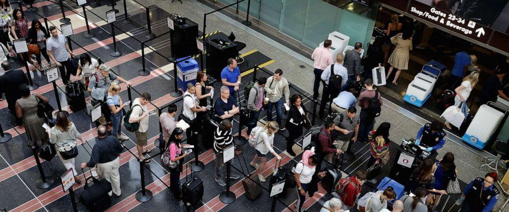 PHOTO: Passengers queue up outside a TSA checkpoint at Ronald Reagan National Airport, May 27, 2016 in Arlington, Va.
