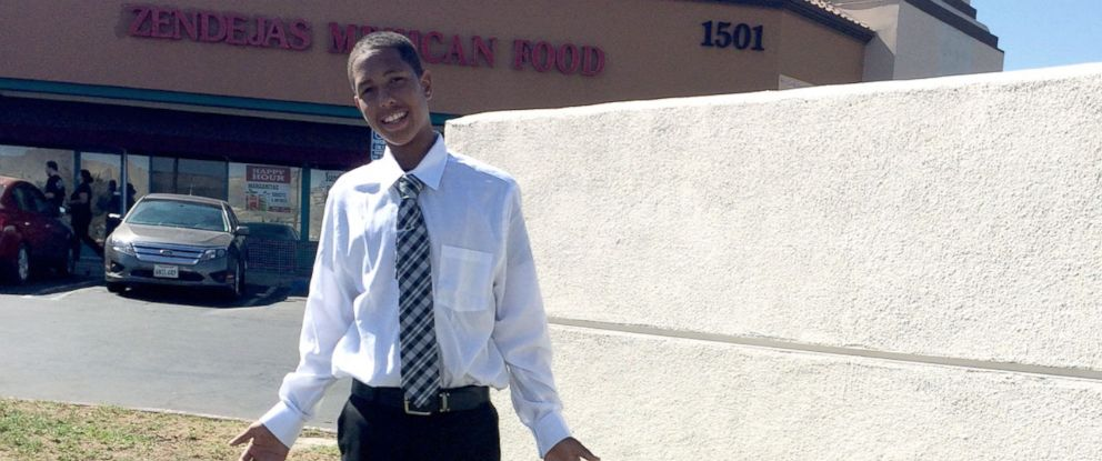 """PHOTO: Anthony """"AJ"""" Weber, 16, dressed in formal attire and smiling."""