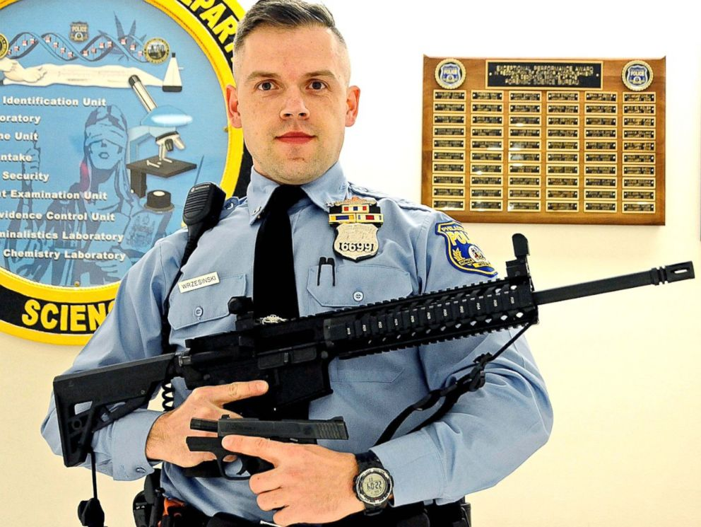 PHOTO: Officer Krzysztof Wrzesinski arrested a 12-year-old for having an AR-15 and his 19-year-old brother for possession of a handgun.