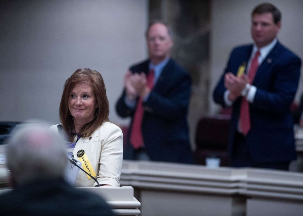 PHOTO: State Rep. Terri Collins gets a standing ovation after her near total ban on abortion bill passed the House at the Alabama Statehouse in Montgomery, Ala., on Tuesday, April 30, 2019.