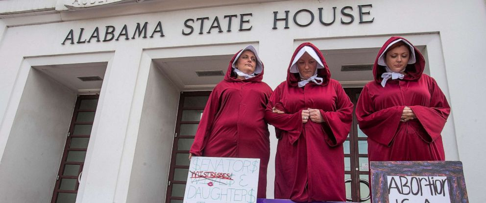 PHOTO: Abortion rights supporters dressed as handmaids take part in a protest against HB314, the abortion ban bill, at the Alabama Statehouse in Montgomery, Ala., April 17, 2019.
