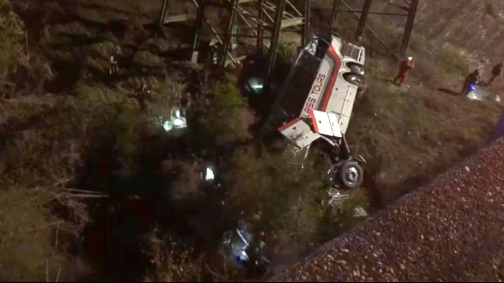 Emergency personnel  working the site of a bus crash on I-10 in Alabama. The bus was carrying high school band students from the Houston area according to school officials.