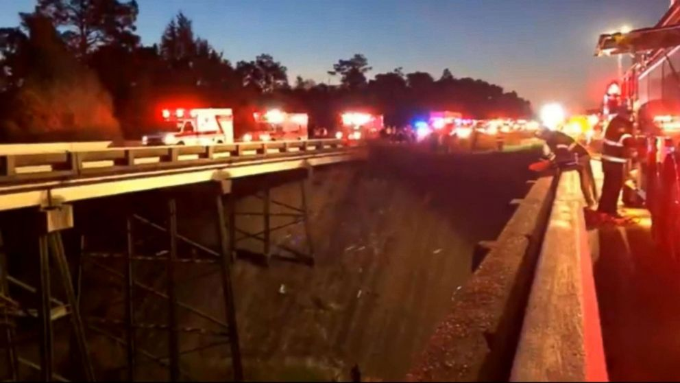 PHOTO: Emergency vehicles and personnel at the site of a bus crash on I-10 in Alabama. The bus was carrying high school band students from the Houston area according to school officials.