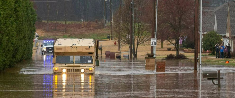 PHOTO: A Muscle Shoals police vehicle pushes through flood waters that cover Melissa Drive in Nathan Estates helping those who need to be evacuated, Friday, Feb. 22, 2019, in Muscle Shoals, Ala.