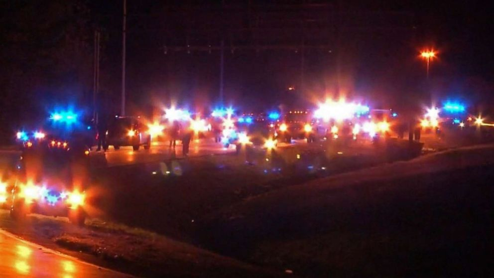 """Protesters angry over the shooting death of Emantic Fitzgerald """"E.J."""" Bradford Jr. pass through part of an interstate in Hoover, Ala., Dec. 4, 2018."""