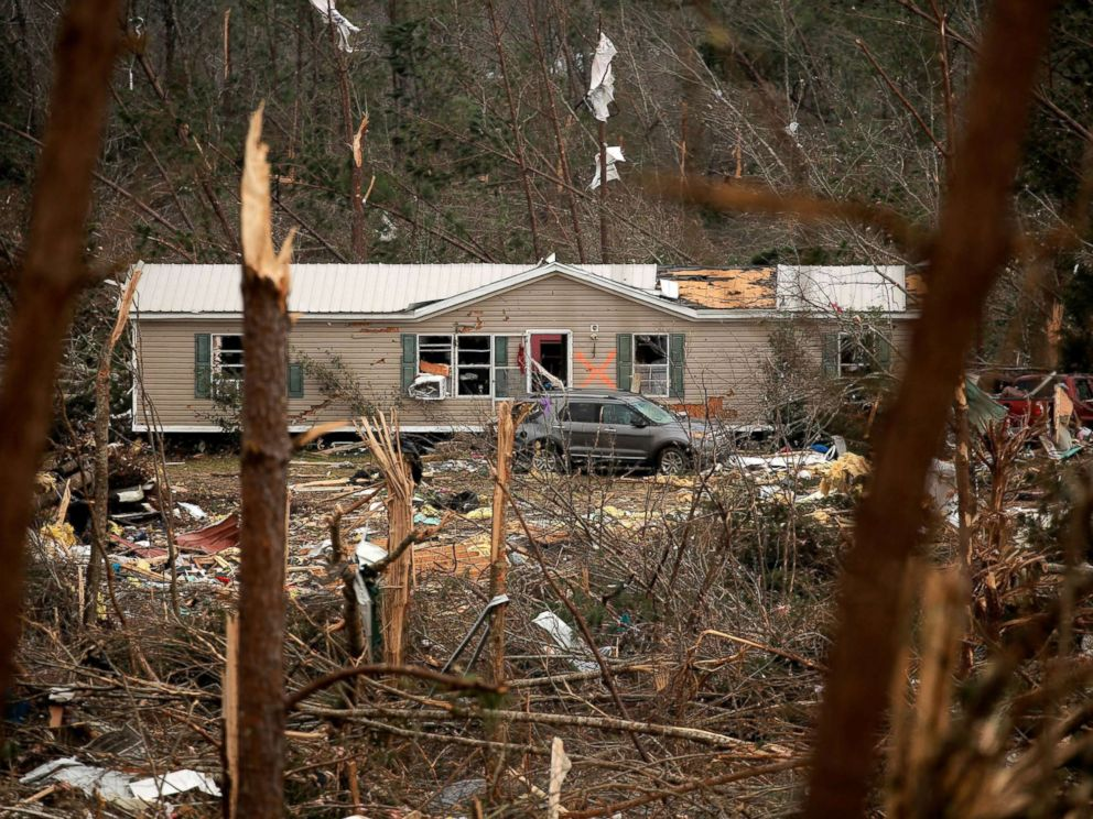 PHOTO: A house with an X painted on it is seen across a hillside of wreckage after two deadly back-to-back tornadoes, in Beauregard, Ala., March 4, 2019.